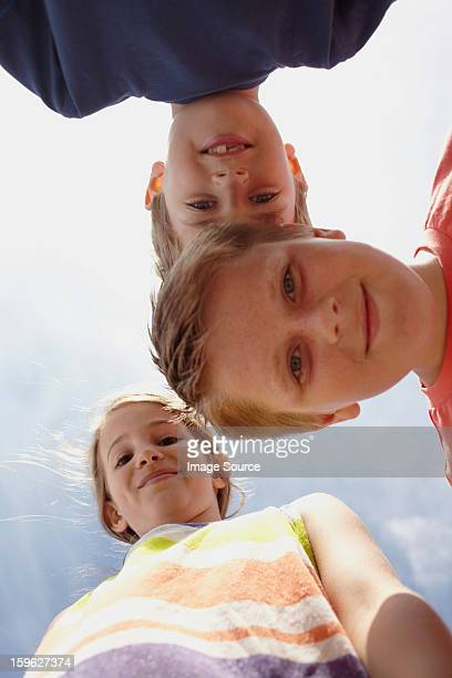 girl and two boys looking at camera, viewed from below - saltdean stock pictures, royalty-free photos & images