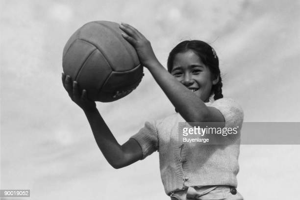 Girl and volley ball Ansel Easton Adams was an American photographer best known for his blackandwhite photographs of the American West During part of...