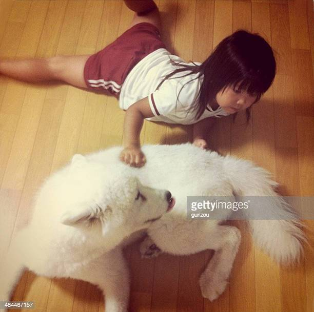 A girl and white dog