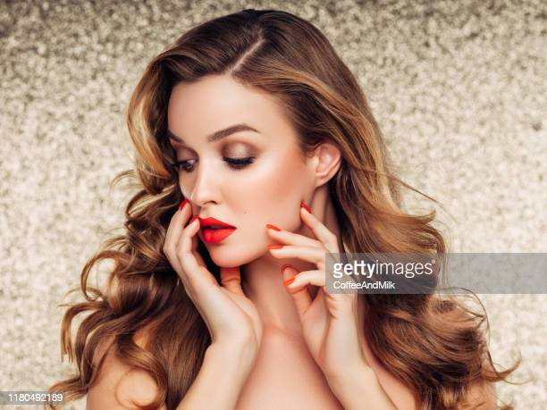 girl applying red lipstick on her lips - one young woman only stock pictures, royalty-free photos & images