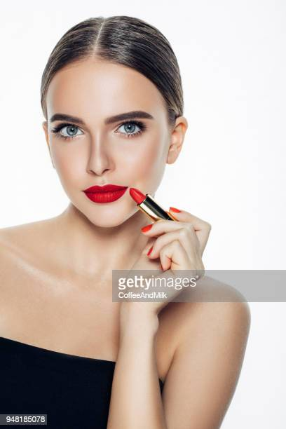 girl applying red lipstick on her lips - lipstick stock pictures, royalty-free photos & images