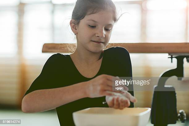 girl applying sport chalk on her hands. - horizontal bars stock pictures, royalty-free photos & images