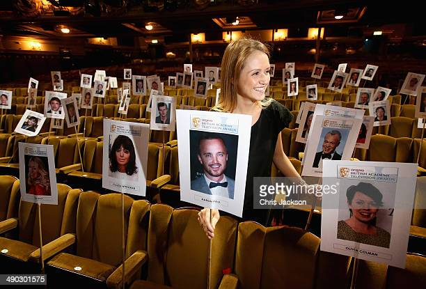 A girl arranges 'heads on sticks' in preparation for the Arqiva British Academy Television Awards at the Theatre Royal on May 14 2014 in London...