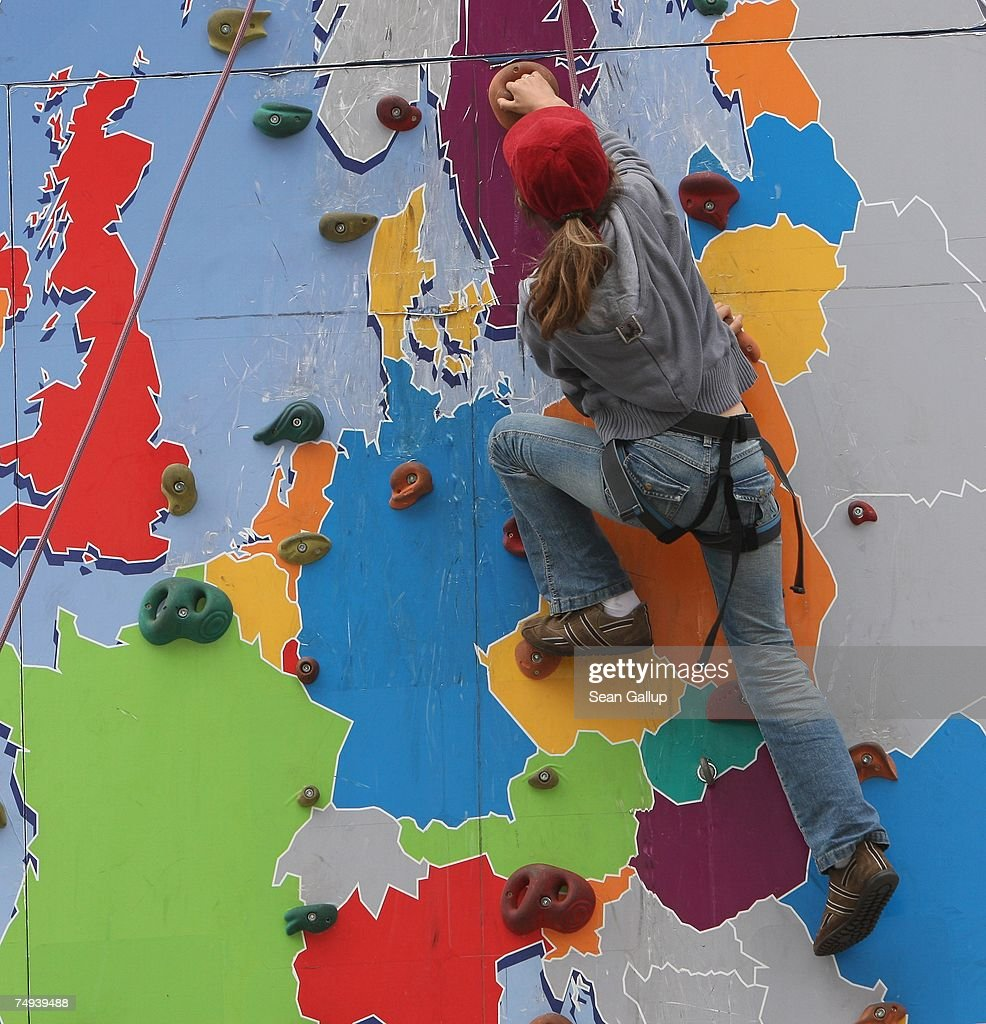 European union turns 50 photos and images getty images a girl ascends a climbing wall with a map of the european union at an eu gumiabroncs Choice Image