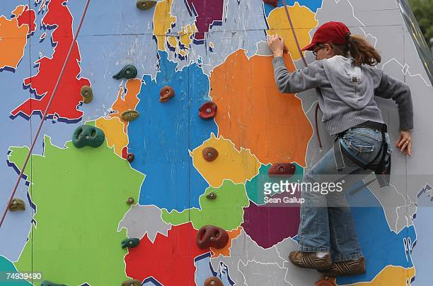 A girl ascends a climbing wall with a map of the European Union at an EU sponsored promotional event June 28 2007 in Berlin Germany The European...