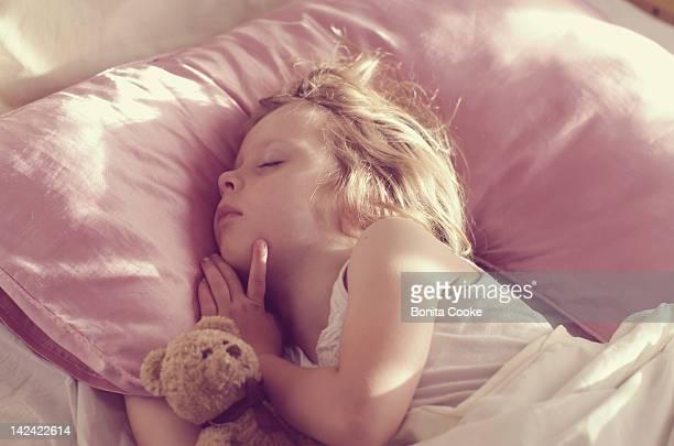 Girl asleep, early morning