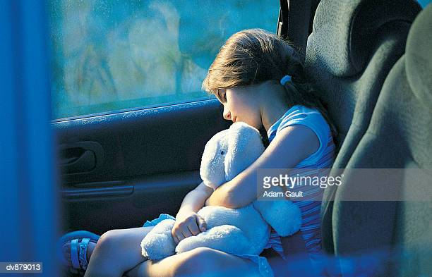 Girl Asleep in a Car With a Cuddly Toy