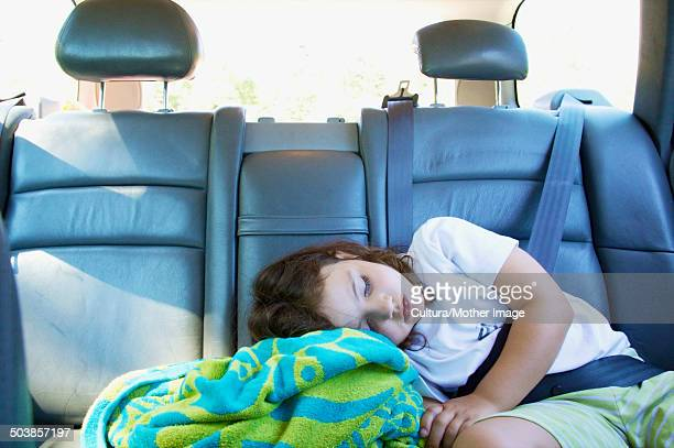 Girl asleep in car with seat belt on