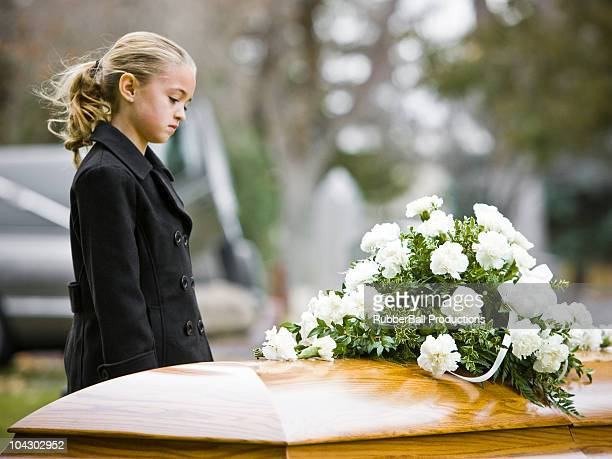 girl at a funeral - orphan stock pictures, royalty-free photos & images