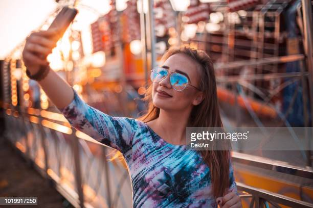 girl at a funfair - digital native stock photos and pictures