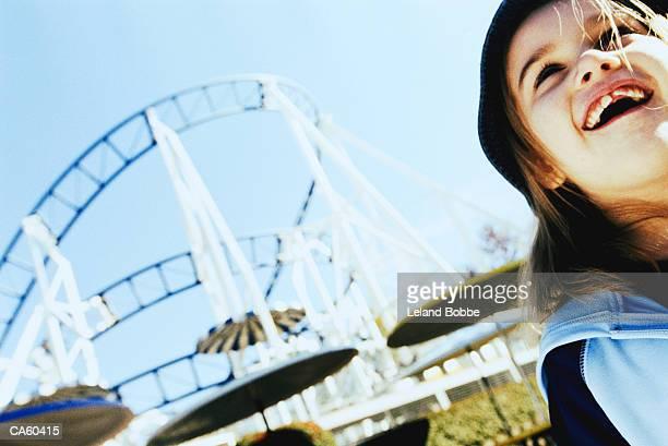 Girl (6-8) at amusement park, close-up