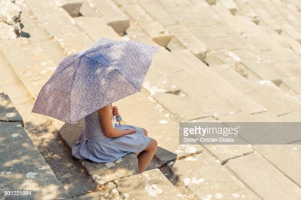 Girl at ancient Theater of Epidaurus in Greece