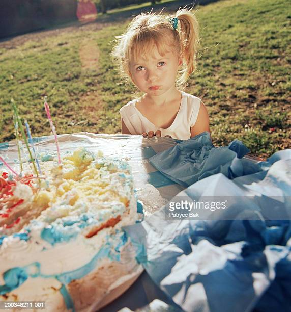 Girl (4-6) at birthday party in park