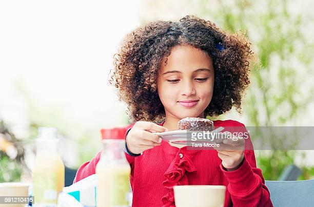 girl at cafe eating cake