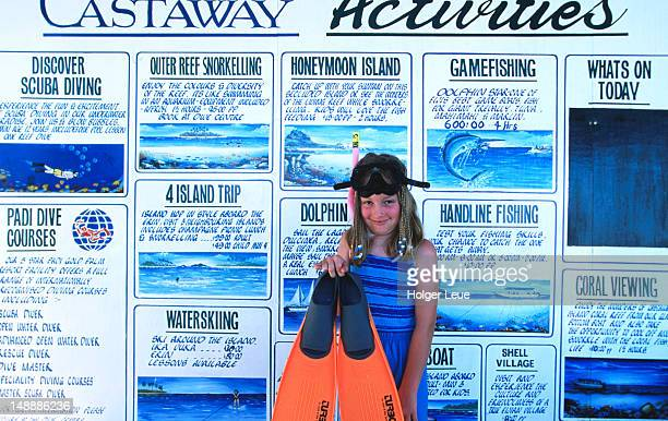 Girl at Castaway activities board, Castaway Island.