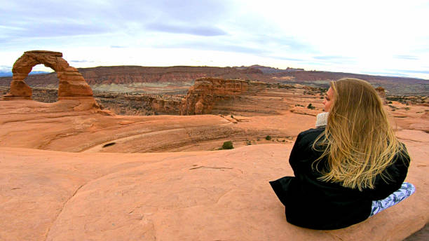 girl at delicate arch, Arches National Park