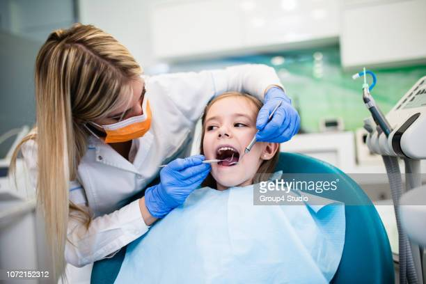 girl at dentist office - pediatric dentistry stock photos and pictures