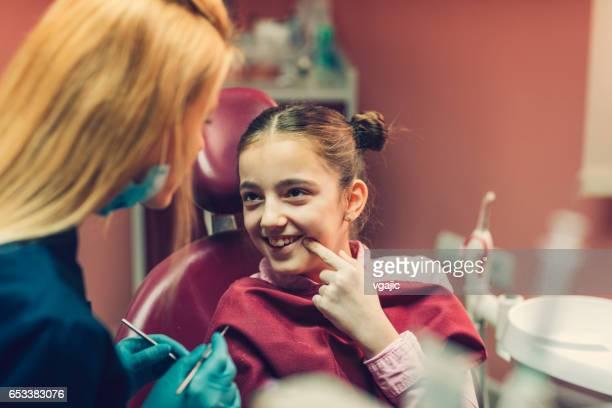 Girl at dentist office
