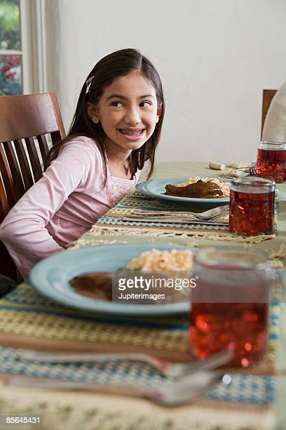 girl at dining table - mole sauce stock pictures, royalty-free photos & images