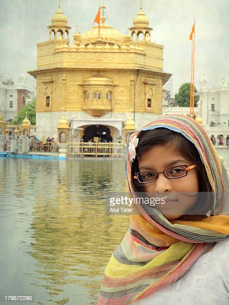 a girl at golden temple - punjabi girls images stock photos and pictures