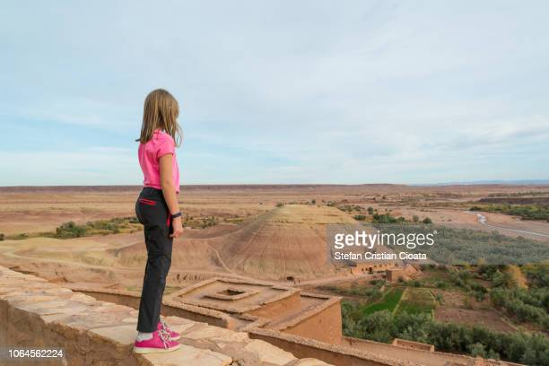 girl at ksar of ait-ben-haddou - ancient civilization stock photos and pictures
