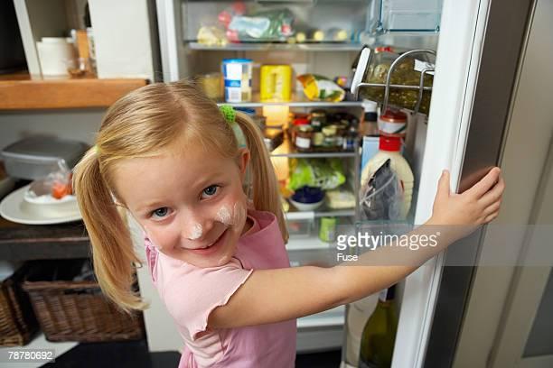 Girl at Open Refrigerator