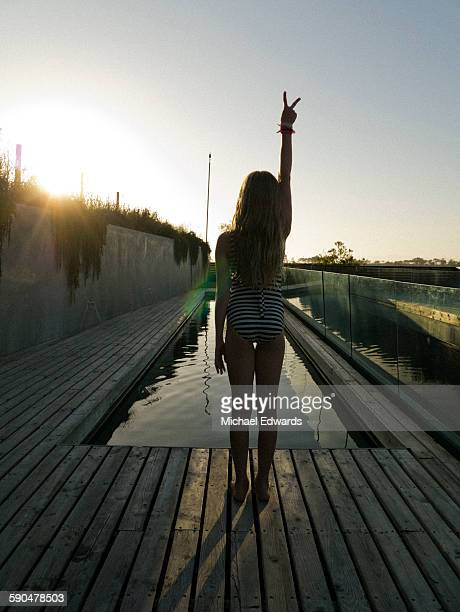 girl at pool sunset