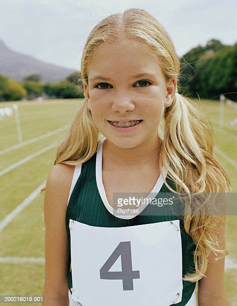 girl (10-12) at school sports day, smiling, portrait, close-up - 10 11 years stock photos and pictures
