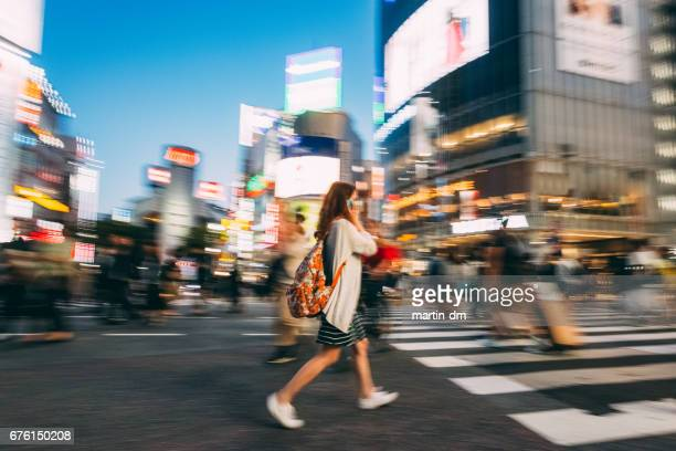 girl at shibuya crossing - pedestrian crossing sign stock photos and pictures