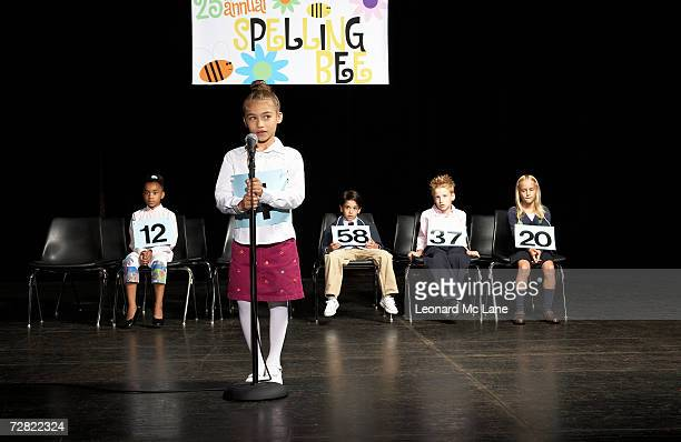 Girl (6-7) at spelling bee competition