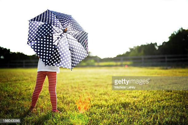 Girl at sunset with umbrella
