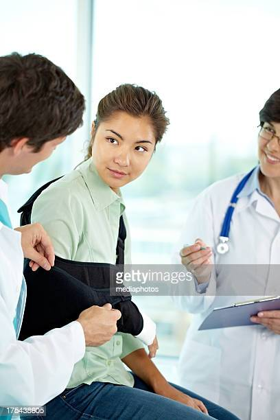 girl at surgery - arm sling stock pictures, royalty-free photos & images