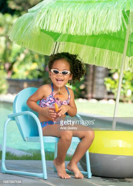 Girl at Swimming Pool Drinking Fruit Punch
