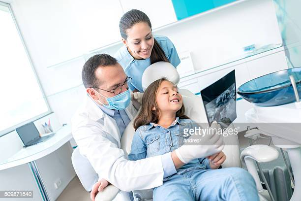 Girl at the dentist looking at an x-ray