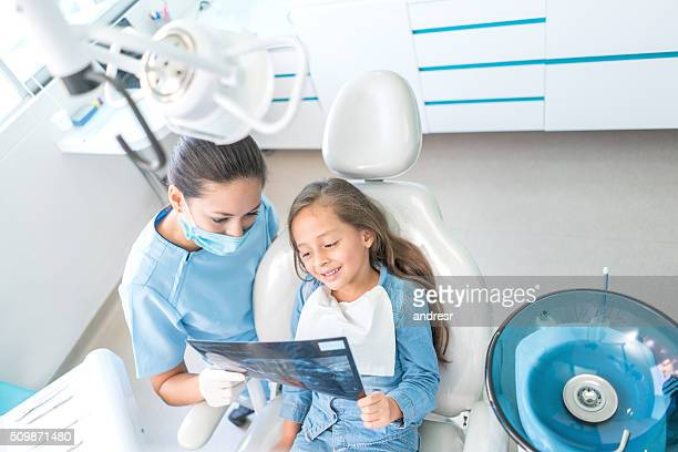 Girl at the dentist looking at her x-ray
