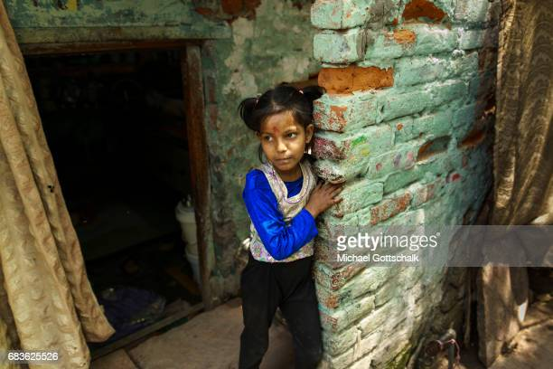 A girl at the entrance of an apartment in the slum of the city district Seemapuri where the Caritas and the NGO Chentanalaya support urban marginal...