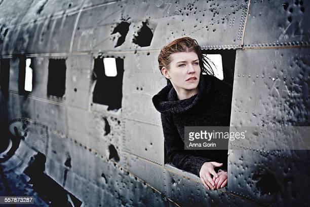 Girl at window of battered plane crash