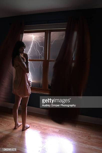 Girl at window, storm