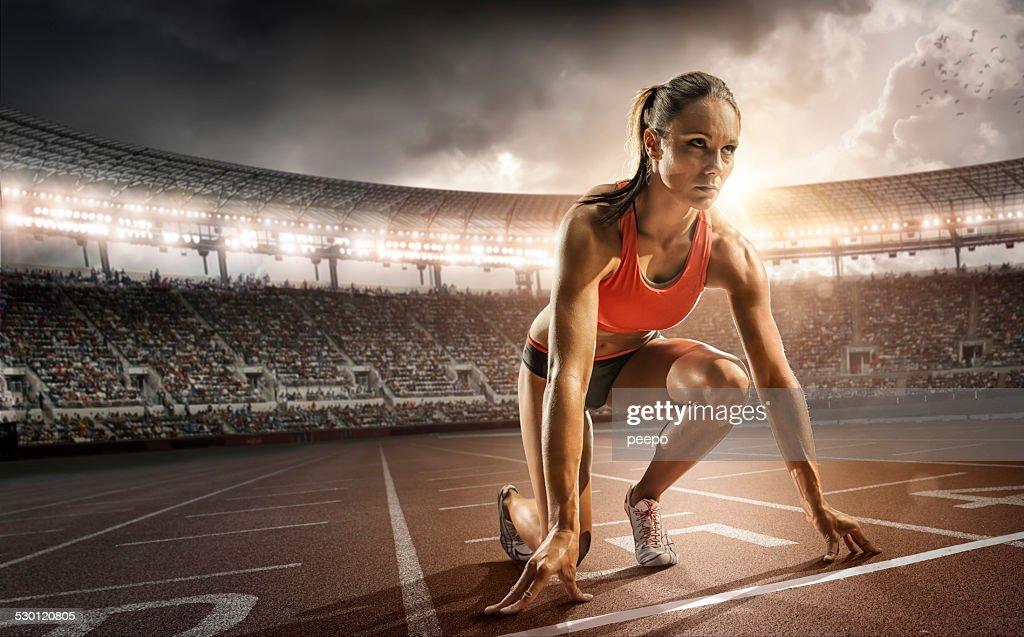 Girl Athlete Getting Ready to Run : Stock Photo