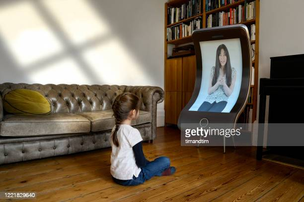 girl attending an online class with a giant smartphone - attending stock pictures, royalty-free photos & images