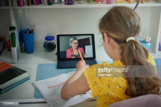 girl attending online school class - ホームスクーリング ストックフォトと画像