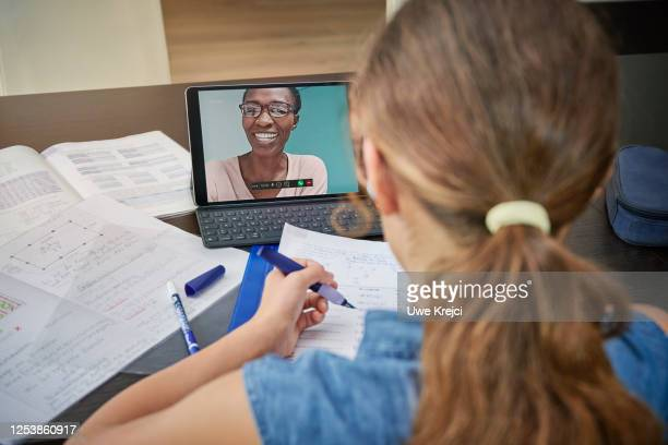 girl attending online school class - distance learning stock pictures, royalty-free photos & images