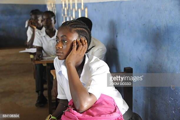 A girl attends a class in a school in Monrovia on April 15 2016 For the new school year the Liberian government plans to roll out a publicprivate...