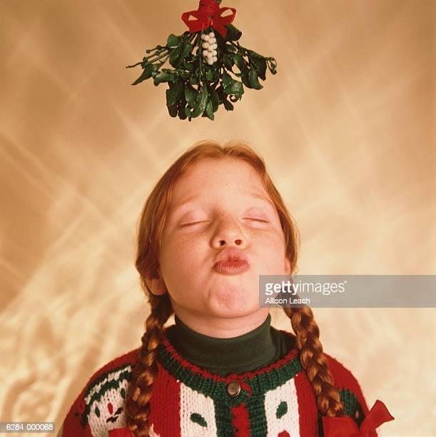 girl awaits kiss - mistletoe stock photos and pictures