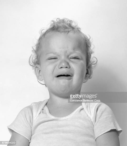 girl baby crying - constance bannister stock photos and pictures