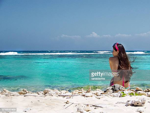 girl back in a caribbean beach - child super models stock pictures, royalty-free photos & images