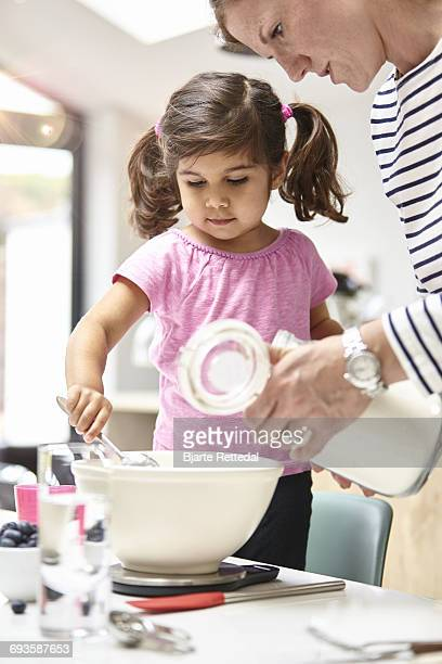 girl baking a cake - bjarte rettedal stock pictures, royalty-free photos & images