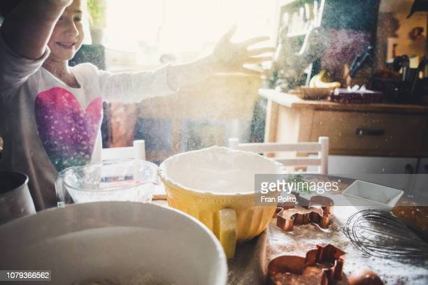 a girl baking cookies. - imperfection stock pictures, royalty-free photos & images
