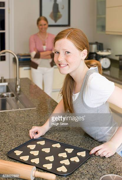 girl baking cookies - hugh sitton stock pictures, royalty-free photos & images