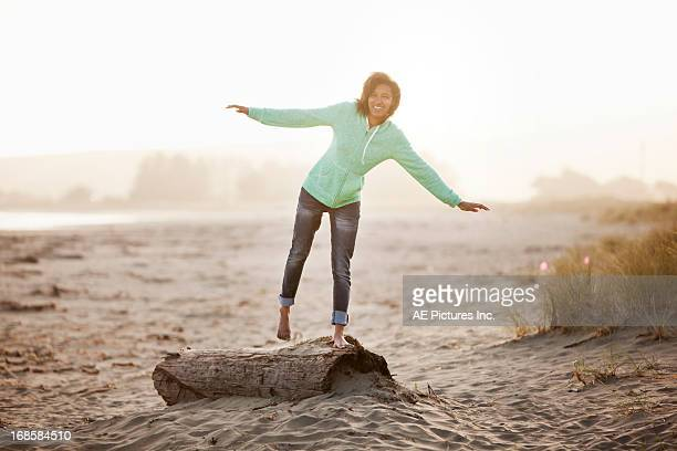 Girl balances on log